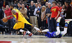 March 3, 2017 - Atlanta, GA, USA - Cavaliers guard Kyrie Irving, who led the team with 43 points, is fouled while driving past Hawks guard Dennis Schroder in the final minutes of a 135-130 victory in a NBA basketball game at Philips Arena on Friday, March 3, 2017, in Atlanta, GA. (Credit Image: © Curtis Compton/TNS via ZUMA Wire)