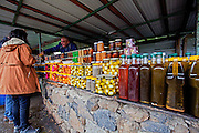 Israel, Golan Heights, Apples, Jars of labaneh, (soft white goat's milk cheese), and Olives, being sold by Druse residents near the Saar waterfall