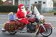 Matt Johnson of Langhorne, dressed as Santa while riding his Indian Motorcycle along with other members of the Delaware Valley Iron Indian Riders Association who held their annual Ride Of the Santas and dropped off toys to children at  Saturday, December 21, 2019 at St Francis-St Vincent Home For Children in Bensalem, Pennsylvania. (Photo by William Thomas Cain / CAIN IMAGES)