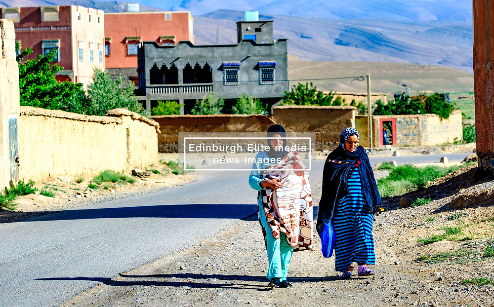 Two young women in traditional dress walking in the village of Tamtetoucht at the foot of the High Atlas in Morocco<br /> <br /> (c) Andrew Wilson | Edinburgh Elite media