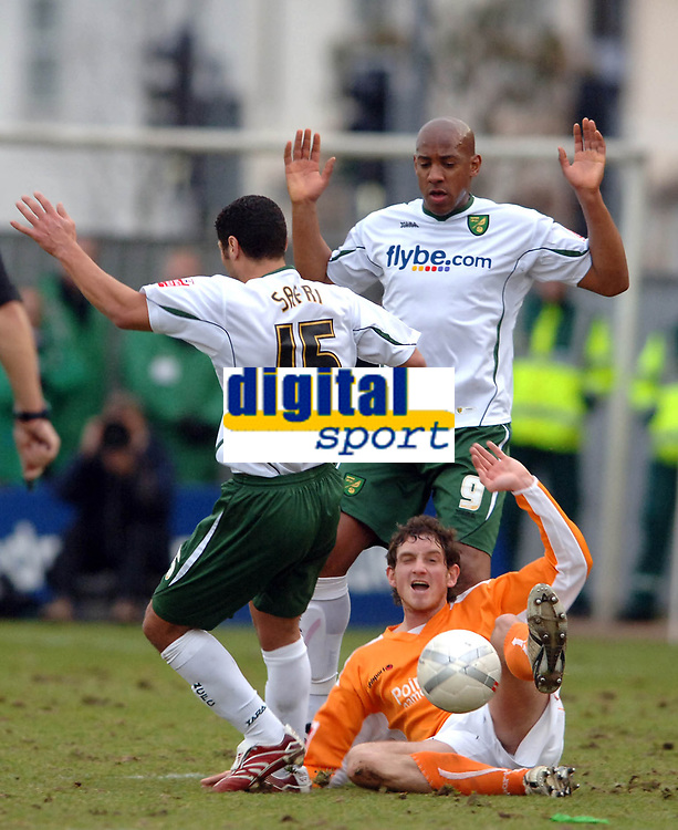 Photo: Paul Greenwood.<br />Blackpool v Norwich City. The FA Cup. 27/01/2007. Dion Dublin, background, protests his innocence as Blackpool's Scott Vernon, centre, cries for a foul