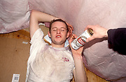 A drunk man, looking wasted, refusing a can of Stella, UK 2004<br />