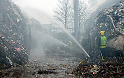 © Licensed to London News Pictures. 21/03/2013.Waste4fuel recycling centre fire continues to burn today (21.03.2013) after four days.. Firefighters are now in their 4th day of  tackling a fire affecting a large amount of waste at a recycling plant off Sevenoaks Way in Orpington,South East London..Three fire engines and 14 firefighters are at the scene in Cornwall Drive, Orpington, trying to damp down the several thousand tonnes of waste that are still smouldering..Six fire engines with 35 firefighters and officers were called to the fire at 5.47am on Monday morning (March 18)  from Eltham, Orpington, Sidcup, Bethnal Green, and Bromley fire stations..Photo credit : Grant Falvey/LNP
