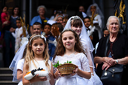 © Licensed to London News Pictures. 21/07/2019. LONDON, UK.  Children prepare to take part in the Procession of Our Lady of Mount Carmel, starting at St Peter's Italian Church and then around the streets of Clerkenwell.  Floats carry life size depictions of Biblical scenes in a Catholic festival which has taken place annually for 100 years in the area which was once the capital's Little Italy.  Photo credit: Stephen Chung/LNP
