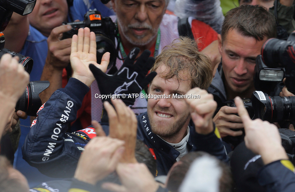 World Champion 2012 - Sebastian VETTEL, Germany, D, Red Bull Racing Renault F1 Team - Celebration - Vettel ist Weltmeister, Jubel - <br /> F1 Grand Prix in BRAZIL, Sao Paulo , Interlagos - Formula One, Formel 1, Weltmeister - Champion du Monde  Formule 1 - race  - fee liable image - Photo Credit: &copy; ATP / NELSON Antoine