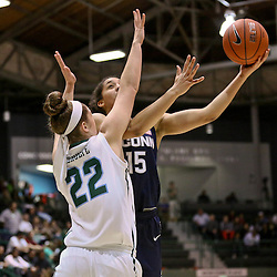 Feb 3, 2016; New Orleans, LA, USA; Connecticut Huskies guard Gabby Williams (15) shoots over Tulane Green Wave guard Meredith Schulte (22) during the second half of a game at the Devlin Fieldhouse. Connecticut defeated Tulane 96-38. Mandatory Credit: Derick E. Hingle-USA TODAY Sports