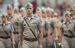 Texas A&M Corps of Cadets Commander Brad Sauer leads the group into Kyle Field before the start of an NCAA college football game between Texas A&M and Louisiana-Lafayette Saturday, Sept. 16, 2017, in College Station, Texas. (AP Photo/Sam Craft)
