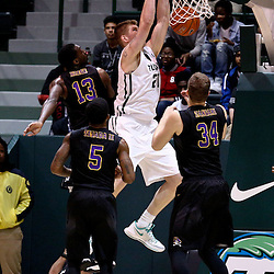 Feb 24, 2016; New Orleans, LA, USA; Tulane Green Wave forward Dylan Osetkowski (21) dunks over East Carolina Pirates forward Michel Nzege (13) and forward Michael Zangari (34) and guard Lance Tejada (5) during the first half of a game at the Devlin Fieldhouse. Mandatory Credit: Derick E. Hingle-USA TODAY Sports