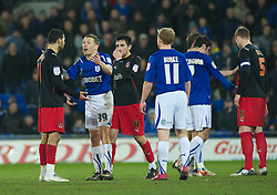 CARDIFF, WALES - Tuesday, February 1, 2011: Cardiff City's Craig Bellamy speaks to Reading's Jobi McAnuff  after kicking the ball away during the Football League Championship match at the Cardiff City Stadium. (Photo by Gareth Davies/Propaganda)