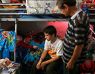 CAPTION: (Port Richey 09/27/2006) (photo 1) Cephas Robinstein (cq), 12, sits beside the body of his deceased younger brother Terran Robinstein (cq), 10, as he is comforted by their father, Dennis Robinstein during Terran's home funeral Wednesday (9/27/06) at their Port Richey house. Terran died at a Miami Hospital on Sunday from complications from his 7 organ transplant SUMMARY: Terran Robinstein is brought home for his friends and family to say their goodbye. His mom, Kimberly Robinstein, wants to have him in his bed without tubes one last time before his burial on Friday. Terran's brother Cephas Robinstein will also be there. erran was born with Hirschsprung's disease (a portion of his intestine lacks ganglion cells). He also suffers from Chronic Intestinal Pseudo Obstruction (bowel doesn't work). He died at a Miami Hospital on Sunday from complications from his 7 organ transplant.