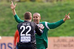 Goalkeeper of Olimpija Jan Oblak and Leonardo Bonifacio of Olimpija  celebrate  at football match of 31st Round of 1st Slovenian League  between NK Olimpija and NK Maribor, on April 16, 2010, in ZAK Stadium, Ljubljana, Slovenia. (Photo by Vid Ponikvar / Sportida)