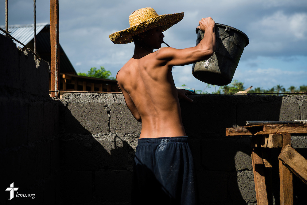 A worker helps build a wall for a new parsonage next to Christ Lutheran Church in Mayahag, Leyte Province, Philippines, on Saturday, March 15, 2014. LCMS Communications/Erik M. Lunsford