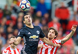 STOKE-ON-TRENT, ENGLAND - Saturday, September 9, 2017: Stoke City's Joe Allen and Manchester United's Henrikh Mkhitaryan the FA Premier League match between Stoke City and Manchester United at the Bet365 Stadium. (Pic by David Rawcliffe/Propaganda)