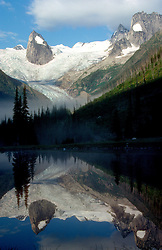 British Columbia, Canada:  Early morning shadows throw the Hound's Tooth peak on Bugaboo Glacier into sharp contrast with its glacial lake surroundings.