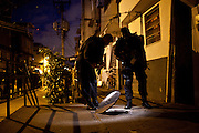 Police officers inspect the sewage system as they occupy the Caju slum complex during a cojoint operation to install a Pacifying Police Unit (UPP) in Rio de Janeiro, Brazil, Sunday, March 3, 2013. The action is part of a program aiming to drive armed drug gangs out of Rio's slums.
