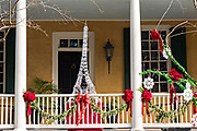 A historic home decorated for Christmas with an Eiffel Tower on Lagare Street in Charleston, SC.