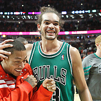 17 March 2012: Chicago Bulls center Joakim Noah (13) celebrates the win with Chicago Bulls point guard Derrick Rose (1) during the Chicago Bulls 89-80 victory over the Philadelphia Sixers at the United Center, Chicago, Illinois, USA.