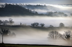 © Licensed to London News Pictures. 26/12/2013. EVERCREECH, UK . Mist at dawn taken from Evercreech in Somerset this morning 26th December 2013. Picture : Jason Bryant/LNP
