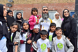 © Licensed to London News Pictures. 14/07/2017. London, UK. A Hajj cyclist is pictured with his family.  Muslim cyclists gather at the East London Mosque in Whitechapel to set out on the 'Hajj Ride', the first ever charity cycle ride from London to Medina in Saudi Arabia.  The 3,500km, 6 week ride will pass through 8 countries raising funds for medical aid in Syria.  Intended to champion cycling in Muslim society, the ride also aims to satisfy one of the five pillars of Islam, being the Hajj pilgrimage to Mecca.  Photo credit : Stephen Chung/LNP