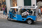 Tuktuk drivers offering tourists sightseeing tours in Lisbon, Portugal