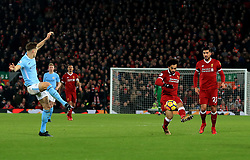 Liverpool's Mohamed Salah scores his side's fourth goal of the game during the Premier League match at Anfield, Liverpool.