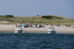 September 4, 2017 - Barnstable, Massachusetts, U.S - Americans enjoy the Labor Day holiday at the ocean at Sandy Neck Beach and Barnstable Harbor on Cape Cod, MASSACHUSETTS, U.S.Bostonians are preparing to ship disaster relief supplies donated by the public to Hurricane Harvey victims in Texas. (Credit Image: © Kenneth Martin via ZUMA Wire)