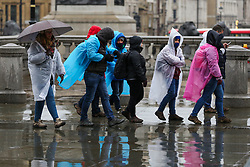 © Licensed to London News Pictures. 15/12/2018. London, UK. Tourists wearing rain poncho during a wet, cold, blustery day in London. Photo credit: Dinendra Haria/LNP