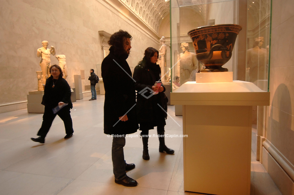 Antonio Maresi, left, and Mary Chiaroni, of Italy, visit the Tarracotta calyx-krater (bowl for mixing wine and water), a piece from the Shelly White and Leon Levy Collection, at the Metropolitan Museum of Art in Manhattan, Thursday, Dec. 8, 2005.