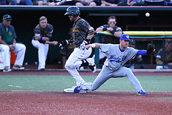 03 June 2016: R.J. Perucki gets to 1st base safely on a ball bobble by first baseman Blair Beck during a Frontier League Baseball game between the Windy City Thunderbolts and the Normal CornBelters at Corn Crib Stadium on the campus of Heartland Community College in Normal Illinois