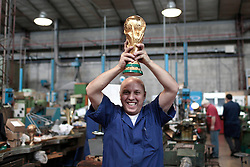 22.02.2014, Bertoni GDE, Mailand, ITA, FIFA WM, FIFA WM POKAL, Gazzaniga, im Bild Ein Mitarbeiter der Firma mit einem Replikat der WM-Trophae // during a Photoshooting of Silvio Gazzaniga, who is designed the FIFA Worldcup Trophy in the Year 1971 at the Bertoni GDE in Mailand, Italy on 2014/02/22. EXPA Pictures © 2014, PhotoCredit: EXPA/ Eibner-Pressefoto/ Cezaro<br /> <br /> *****ATTENTION - OUT of GER*****