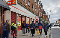 © Licensed to London News Pictures. 31/03/2020. London, UK. Shoppers observe social distancing outside Iceland supermarket in north London as coronavirus lockdown continues. Photo credit: Dinendra Haria/LNP