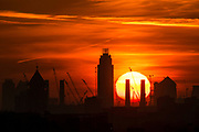 UNITED KINGDOM, London: 19 April 2018 The sun rises behind the chimneys of Battersea Power Station and the London skyline this morning on what will be yet another warm day. Londoners will be enjoying the weather again today as high temperatures are set to continue in the capital. Rick Findler / Story