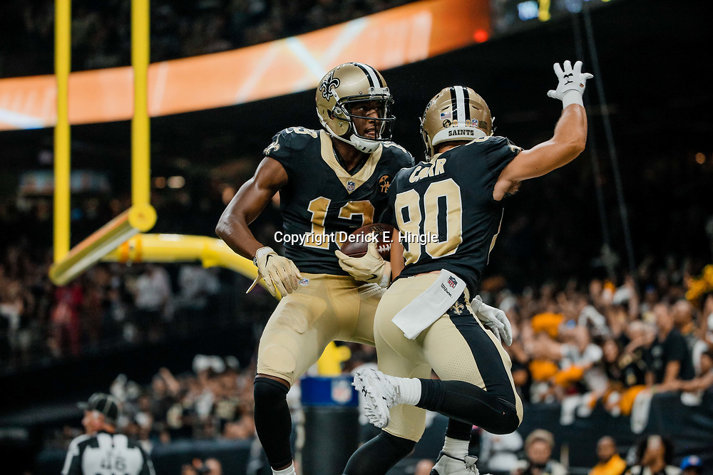 Sep 9, 2018; New Orleans, LA, USA; New Orleans Saints wide receiver Michael Thomas (13) celebrates a touchdown with wide receiver Austin Carr (80) during the second quarter of a game against the Tampa Bay Buccaneers at the Mercedes-Benz Superdome. Mandatory Credit: Derick E. Hingle-USA TODAY Sports