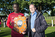 Gerry Dignan of Dundee Schools' FA presents the league Championship shield to Harris Academy captain Imran Madugu - Harris Academy, Dundee Schools FA League Champions, Photo: David Young<br /> <br />  - &copy; David Young - www.davidyoungphoto.co.uk - email: davidyoungphoto@gmail.com