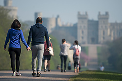 © Licensed to London News Pictures. 10/04/2020. Windsor, UK. Members of the public exercising in the early morning warm weather on the Long Walk at Windsor Castle , the current residence of Queen Elizabeth II, on Good Friday, during a pandemic outbreak of the Coronavirus COVID-19 disease. The public have been told they can only leave their homes when absolutely essential, in an attempt to fight the spread of coronavirus COVID-19 disease. Photo credit: Ben Cawthra/LNP