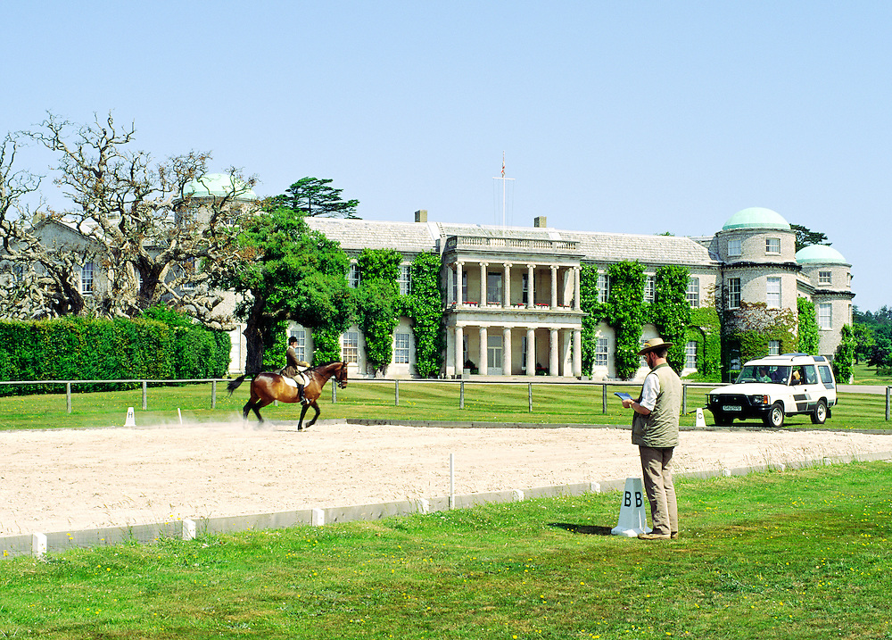 Equestrian centre riding school at Goodwood House, West Sussex, England. Judging dressage competition.