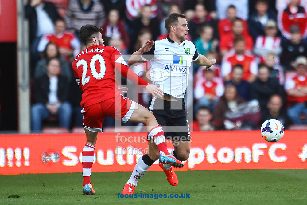 Steven Whittaker of Norwich City is tackled by Adam Lallana of Southampton during the Barclays Premier League match at the St Mary's Stadium, Southampton<br /> Picture by Daniel Chesterton/Focus Images Ltd +44 7966 018899<br /> 15/03/2014