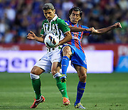 VALENCIA, SPAIN - JUNE 01: (L) Salva Sevilla of Real Betis Balompie competes for the ball with (R) Pedro Rios of Levante UD during the Liga BBVA between Levante UD and Real Betis Balompie at the Ciutat de Valencia stadium on June 01, 2013 in Valencia, Spain. (Photo by Aitor Alcalde Colomer).