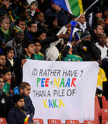 Fans of South Africa hold up a banner and show their support of Steven Pienaar of South Africa and not Kaka of Brazil