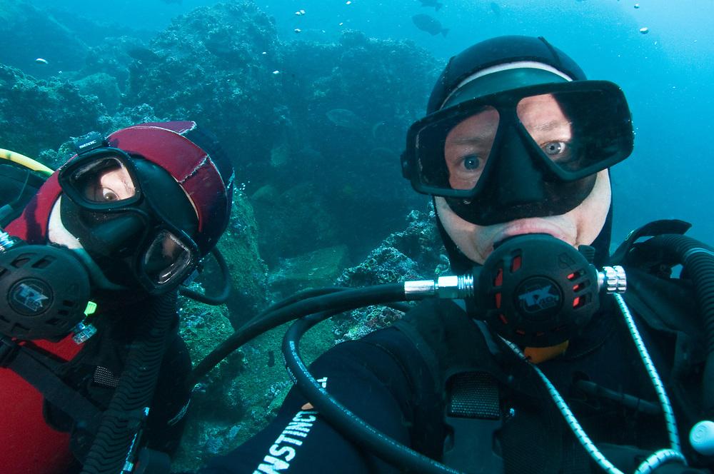 Diver at Galapagos Islands. Looking for sharks. Location: Galapagos, Ecuador