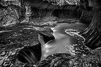 The iconic view of The Subway slot canyon in black and white found in the Zion National Park backcountry.