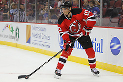 Sep 16, 2013; Newark, NJ, USA; New Jersey Devils defenseman Peter Harrold (10) skates with the puck during the first period of their game against the New York Rangers at Prudential Center.