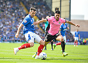 Portsmouth midfielder Gary Roberts Northampton Town Midfielder Danny Rose during the Sky Bet League 2 match between Portsmouth and Northampton Town at Fratton Park, Portsmouth, England on 7 May 2016. Photo by Adam Rivers.
