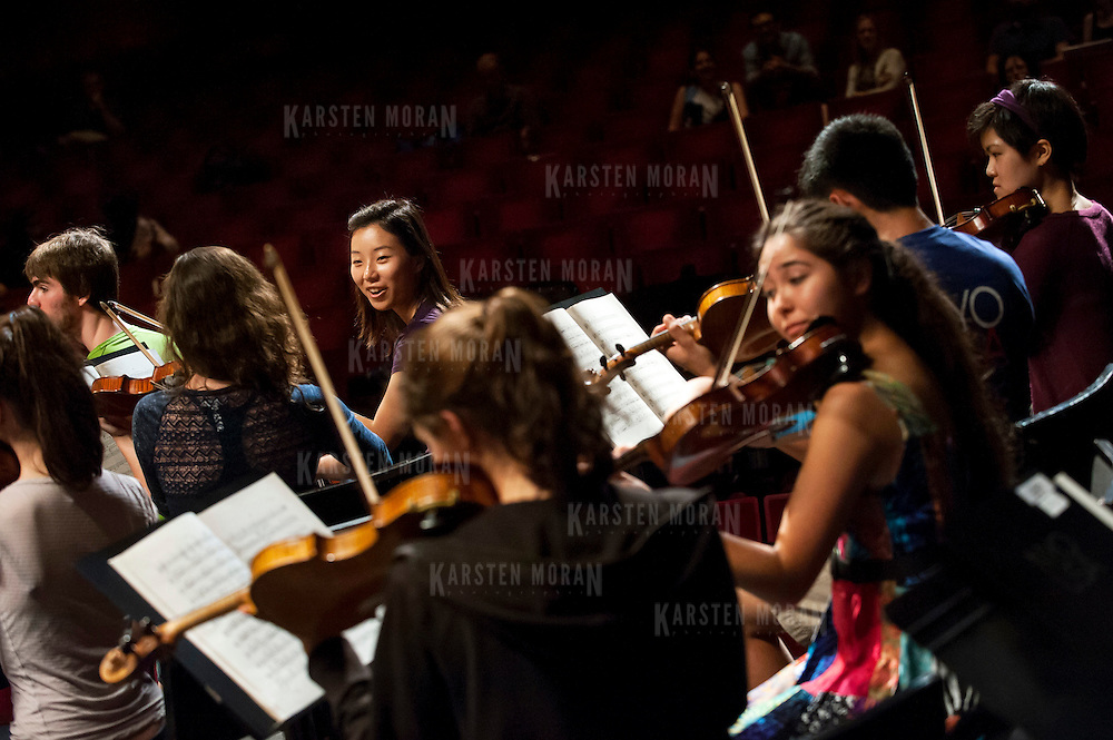 July 9, 2013 - Purchase, NY : Members of the National Youth Orchestra of the United States prepare for a rehearsal with conductor Valery Gergiev (not pictured) at SUNY Purchase's Performing Arts Center in Westchester on Tuesday afternoon. The Orchestra, a new project of Carnegie Hall's Weill Music Institute, is comprised of musicians aged 16-19, hand-picked from across the country. The program -- and orchestra -- will kick off its inaugural season with a performance at SUNY Purchase on Thursday evening, and then head off to perform in Washington DC,  Moscow, St. Petersburg, and London. Popham is from Golden, Colo. CREDIT: Karsten Moran for The New York Times