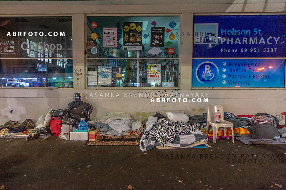 A collection of blankets, pillows and other essentials belonging to the homeless kept outside a pharmacy next to the Auckland city mission on the 6th of June 2018. Asanka Brendon Ratnayake for The New York Times.