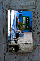 View of courtyard of a blue house through a window architecture, Jodhpur, India. Exotic architecture exotic places, fine art photography prints.