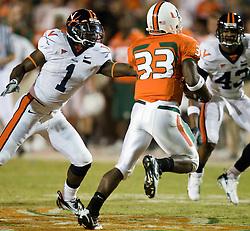 Virginia cornerback Trey Womack (1) wraps up Miami (FL) wide receiver Ryan Lacedonia (33).  The #19 Virginia Cavaliers defeated the Miami Hurricanes 48-0 at the Orange Bowl in Miami, Florida on November 10, 2007.  The game was the final game played in the Orange Bowl.