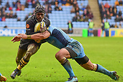 Wasps wing Christian Wade (14) takes a tackle during the Aviva Premiership match between Wasps and London Irish at the Ricoh Arena, Coventry, England on 4 March 2018. Picture by Dennis Goodwin.