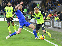 Football - 2018 / 2019 Premier League - Cardiff City vs. Huddersfield Town<br /> <br /> Alex Pritchard of Huddersfield Town challenged by Aron Gunnarsson Cardiff City, at the Cardiff City Stadium.<br /> <br /> COLORSPORT/WINSTON BYNORTH