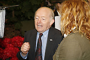 PAUL DANIELS AND CHARLIE DIMMOCK, Press Preview of the RHS Chelsea Flower Show sponsored by Saga Insurance Services. Royal Hospital Rd. London. 22 May 2006. ONE TIME USE ONLY - DO NOT ARCHIVE  © Copyright Photograph by Dafydd Jones 66 Stockwell Park Rd. London SW9 0DA Tel 020 7733 0108 www.dafjones.com